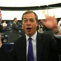 Carry on Britain: United Kingdom Independence Party leader and European lawmaker Nigel Farage waves a Union Jack during a policy session at the European Parliament in Strasbourg, eastern France, in July 2009. | AP