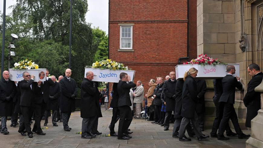 Blazing anger: Coffins holding the bodies of six children who died in a house fire deliberately planned and set by their parents, are carried into St. Mary's Church in Derby, central England, for a funeral service on June 22, 2012.