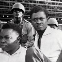 Conspiracy theory: Soldiers guard Congo's first democratically elected prime minister, Patrice Lumumba (right), and Joseph Okito (left), vice president of the Senate, upon their arrest in Leopoldville, now known as Kinshasa, in December 1960. | AFP-JIJI