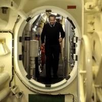 Enemy below: Prime Minister David Cameron inspects a submarine off Scotland's western coast Thursday. | AFP-JIJI