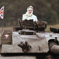 Margaret Thatcher stands in a tank in Fallingbostel, Germany, during a visit with British forces in September 1986. | AP