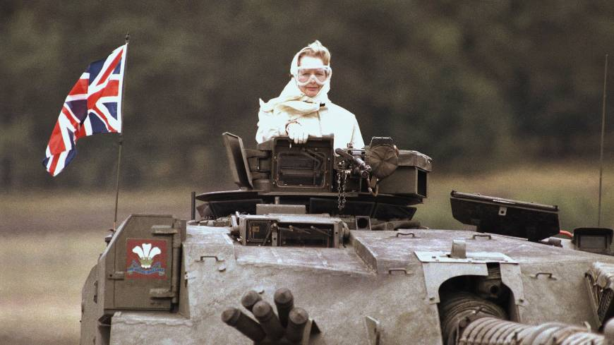 Margaret Thatcher stands in a tank in Fallingbostel, Germany, during a visit with British forces in September 1986.