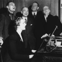 Margaret Roberts (later  Thatcher) accompanies four voters on the piano in a sing-along in Dartford, England, in 1950. | AP