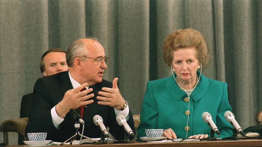 Soviet President Mikhail Gorbachev talks to  Thatcher during their joint news conference in Moscow in June 1990.