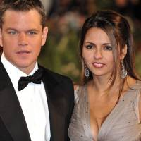 No frills: 'My wife's a civilian and that takes a lot of pressure off,'says Matt Damon, seen here with his wife, Luciana Bozan, at the 2009 Venice Film Festival. N. | GENIN