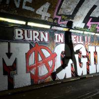 The underworld: A pedestrian tunnel is adorned with graffiti that reads 'Burn in hell, Maggie,' referring to late British Prime Minister Margaret Thatcher, in London on Friday. | AFP-JIJI