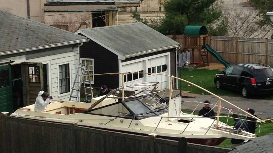 Investigators on Saturday probe the boat and surrounding area where Tsarnaev was captured a day earlier.