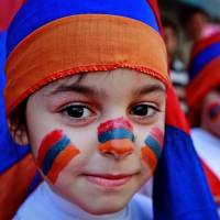 Patriotic pride: Lebanese-Armenian boys, their faces painted with the colors of the Armenian flag, attend a rally in Beirut on Wednesday marking the 98th anniversary of massacres of thousands of Armenians. | AP