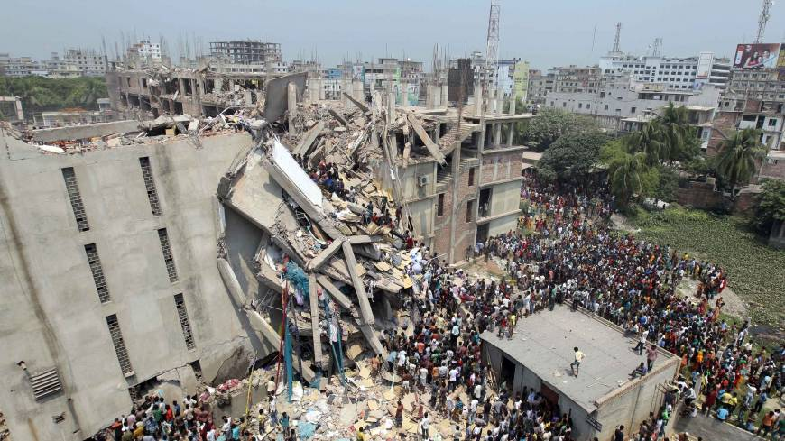 Looking to help: People gather after an eight-story building collapsed in Savar, near Dhaka, on Wednesday.