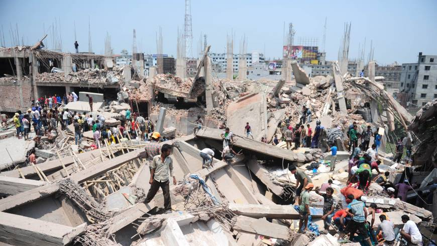 Desperate: Civilian volunteers assist in rescue operations after an eight-storey building collapsed in Savar, near Dhaka, on Wednesday.