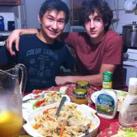 Buddies: Boston Marathon bombing suspect Dzhokhar Tsarnaev (right) poses with college friend Dias Kadyrbayev in photo taken from the VK social-networking site. | AP