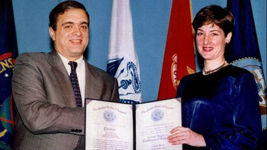 Two faces: In 1997, CIA Director George Tenet awards Ana Montes the Certificate of Distinction, the third-highest national-level intelligence honor. While Montes was excelling at her U.S. government job, she also was spying for Cuba. At right, her FBI booking photo on the day of her arrest, Sept. 21, 2001.