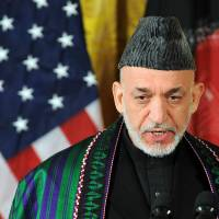 Money matters: Afghan President Hamid Karzai answers a question during a joint news conference with U.S. President Barack Obama in the East Room of the White House in Washington in January. | AFP-JIJI