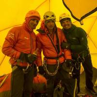 Friends in high places: Ueli Steck (left) of Switzerland and Simone Moro (right) of Italy, stand with British alpine photographer Jonathan Griffith in a tent following an altercation with Nepalese Sherpa guides at Camp Two on Mount Everest on April 27. | AFP-JIJI