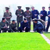 Turf war: Military officials take notes as North Korean leader Kim Jong Un inspects a grass lawn at the Turf Institute of the Bioengineering Branch under the State Academy of Sciences in Pyongyang. | AFP-JIJI