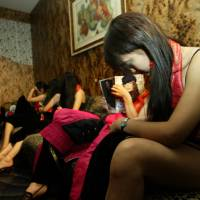 Chinese prostitutes 'routinely extorted, abused'