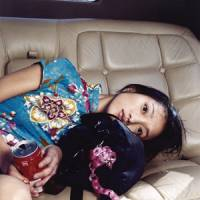 Driving force: 'Zhou Xun dans une limousine' (2002, Shanghai) | ©BETTINA RHEIMS