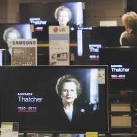 Multiple views on the Iron Lady: A customer watches the news on television screens in a London department store following the death of former U.K. Prime Minister Margaret Thatcher on April 8. | BLOOMBERG