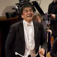 Code of conduct: Yutaka Sado walks back to the stage after leading a concert with the Berlin Philharmonic in Berlin, Germany, Friday, May 20, 2011. | AP PHOTO