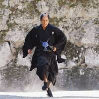 Kakuma, played by Hidetoshi Nishijima, jumps to action.