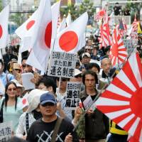 Let them eat cake: While a right-wing group marches against Korean residents in the Okubo district, the media is focused on food safety. | SATOKO KAWASAKI