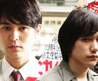Men at arms: Sawada (Satoshi Tsumabuki, left) and Umeyama (Kenichi Matsuyama) fight for their rights in 'My Back Page,' a film based on writer Saburo Kawamoto's accounts of Japan's student riots of the 1960s and '70s. | (C) 2011 EIGA