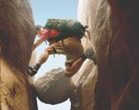 Rock, meet hard place: Aron Ralston (James Franco) heads for trouble &#8212; and some shocking solutions &#8212; in '127 Hours.' | &#169; 2010 TWENTIETH CENTURY FOX