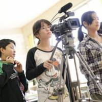 Rated PG: Children learn the basics of making movies in the documentary 'Ima Tsutaetaikoto: Kitto Waraeru.' | PHOTOSCOURTESY OF THE FILMMAKERS