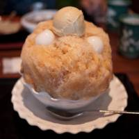 Chilling in the kitchen: A bowl of kakigori (shaved ice) topped with sweet syrup, mochi rice dumplings and ice cream is one of many delicious ways to keep cool this summer. | MAKIKO ITOH