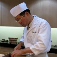 Fresh cuts: Executive chef Akio Saito prepares hamo eel, a summer specialty.