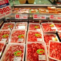 Pigging out: A selection of pork on display at the Granpark Tamachi branch of Daimaru Peacock supermarket. | YOSHIAKI MIURA PHOTO