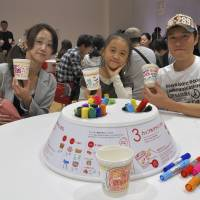 Creativity at play: The Mutou family from Yokohama show off their cup designs, before choosing from the ingredients (top photo). | ANDREW LEE