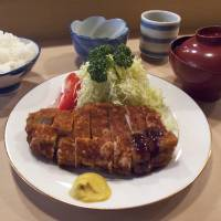 Katsu cradle: Tonki has prepared its distinctive tonkatsu (deep-fried breaded pork cutlets) since 1939. The cutlets are deep-fried slowly and taste more home-cooked than those at other more modern restaurants. | ROBBIE SWINNERTON