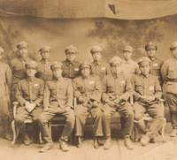At ease: Hiromichi Nagatomi (front row, center), who served with the Tokumu Kikan (Special Services Section) in China, pictured with comrades in arms. He is one of more than 200 ex-servicemen who 32-year-old Sinitirou Kumagai has interviewed. | SINITIROU KUMAGAI