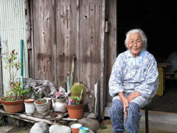 At ease: Yasuko Fukuyama, 83, at home in the hamlet of Nigura. Her children want her to join them in Nagano, but she insists she's not lonely, and says, 'I like it here — the country and the mountains.' | WINIFRED BIRD