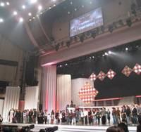 Pep talk: NHK's Keisuke Inoue, the 2009 show's chief producer, addresses its 50-plus performers assembled at a rehearsal for 'Kohaku' held a day before the musical spectacular was broadcast live nationwide on New Year's Eve.