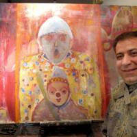 Art on the side: Iranian artist Mansour Kordbacheh poses with his painting 'Oya to Ko' ('Parent and Child') during an interview Jan. 19 at Kamon, his pub in Itabashi Ward, Tokyo. | MARIKO KATO PHOTO