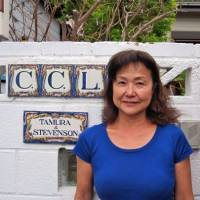 Akiko Tamura poses in front of her home in Yokohama. | COURTESY OF AKIKO TAMURA