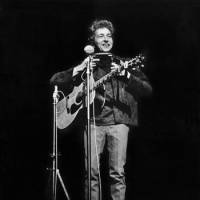 Dylan at age 23 on stage at the Philharmonic Hall in New York on Oct. 31, 1964.