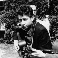 Dylan at the Indian Neck Folk Festival at Branford, Connecticut, on May 6, 1961, when he was 19. | PHOTOS COURTESY OF SONY MUSIC JAPAN INTERNATIONAL INC.