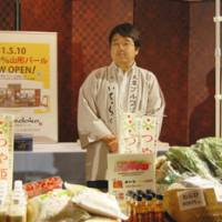 A rice vender from Yamagata exhibits the prefecture's farm products.