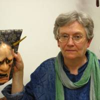 Rebecca Ogamo Teele holds a mask she carved herself for the character of Lady Rakujo, the betrayed wife of Prince Genji in the play 'Aoi no ue.' | JANE SINGER