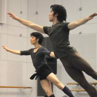 Yamamoto and Fukuoka execute cabriole jumps in the rehearsal studio.