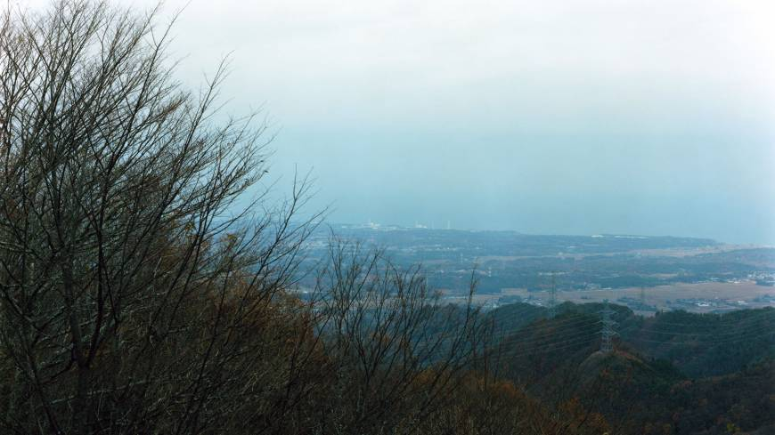 Distant shot: A picture from afar of the Fukushima No. 1 nuclear power plant from Tomoki Imai's book 'Semicircle Law.'