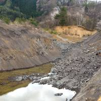 Paying the price: A Nagano Prefecture hill dug away to refill huge holes left by gravel extraction from lowland site. | WINIFRED BIRD