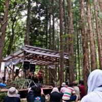 Natural one: Fans gather at the small Mokudo Tei stage at last year's Fuji Rock Festival. The stage is located on the forest boardwalk, and is powered by bio-diesel fuel and solar power. | ALEXIS WUILLAUME