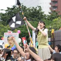 The peace!: Leader of the all-girl group Seifuku Kojo Iinkai sings at an anti-nuclear power demonstration earlier this year. | TAKUMI SUIDU