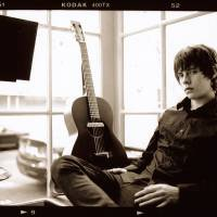 Guitar hero: Nineteen-year-old Jake Bugg says the heavy topics he writes about are not uncommon to a lot of people and that's why he has connected with music fans.