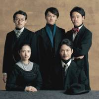Lost in translation: The cast of 'Bedge Pardon,' a production by Koki Mitani. In front are Eri Fukatsu (left), who plays Miss Bedge Pardon, and Mansai Nomura, who plays the role of Natsume Soseki.