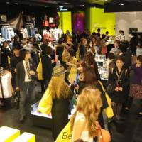 Crowds of visitors peruse clothing at the Bershka openingin Shibuya on April 19.
